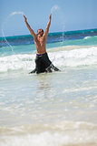 attractive careree happy man in water holiday vacation summer