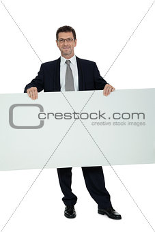 mature smiling businessman holding billboard copyspace isolated