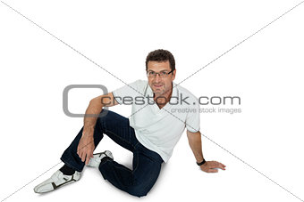 attractive healthy adult man sitting on floor with jeans isolated