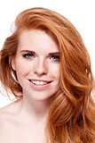 beautiful young redhead woman with freckles portrait