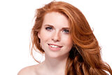 beautiful young smiling woman with red hair and freckles isolated