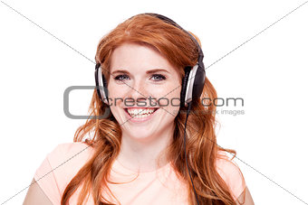 attractive happy woman with headphones listen to music isolated