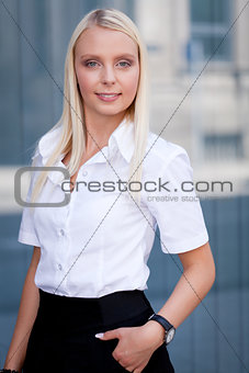 attractive young successful smiling business woman standing outdoor