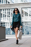 young attractive brunette woman walking on street city life
