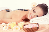attractive helathy caucasian woman hot stone massage wellness