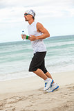 man is jogging on the beach summertime sport fitness