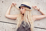 happy young blonde woman with hat outdoor summertime