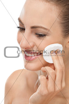 beautiful young woman portrait make up removing isolated