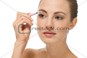 beautiful young woman and eyebrow tweezers