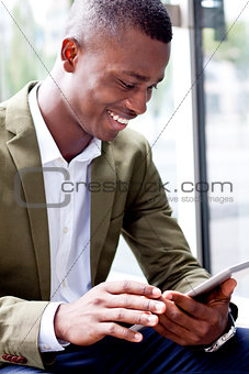 smiling successful businessman with tablet pc outdoor