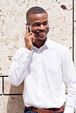young successfil african businessman with mobilephone