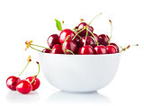 Ripe cherry in plate with green leaf