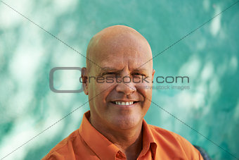Portrait of happy mature hispanic man