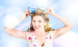 Friendly female pin-up wearing hair accessories