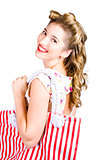 Blonde style girl with shopping bags on white