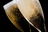 two flutes with champagne gold bubbles
