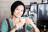 Asian barista enjoy her coffee