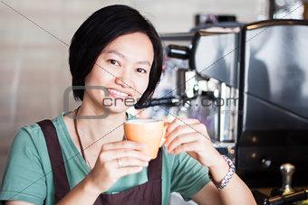 Asian barista enjoy her coffee