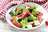 Mediterranean salad with black olives, lettuce, cheese and tomatoes
