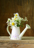 bouquet of fresh daisies camomile on a wooden background