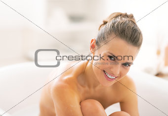 Portrait of young woman in bathtub