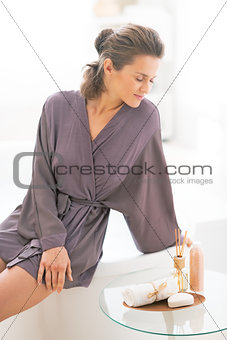 Portrait of relaxed young woman in bathroom