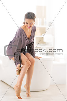 Young woman massaging in bathroom