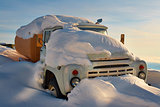 A truck filled with snow