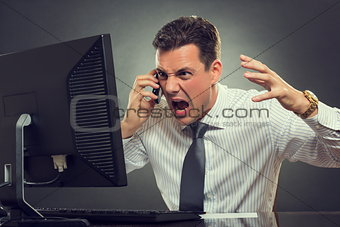 Angry businessman shouting on phone