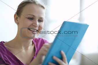 Young woman smiling as she surfs the internet