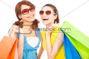 beautiful young sisters holding shopping bags