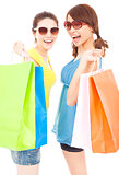 happy pretty young sisters holding shopping bags