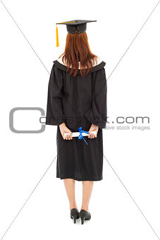 back of  full length beautiful young graduation woman standing
