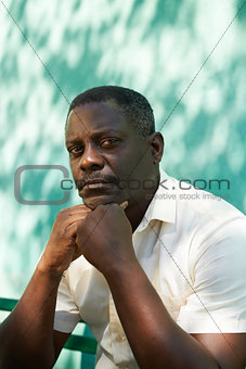 Portrait of middle aged african man staring the camera