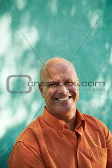 Portrait of happy mature hispanic man