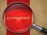 E-Commerce Magnifying Glass on Old Paper.