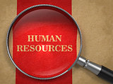 Human Resources Magnifying Glass on Old Paper.