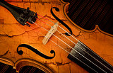 Detail of violin in filtered style as cracked paint
