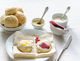 Scones with lemon curd and strawberry jam