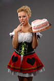 Pretty housewife with a big cake