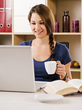 Beautiful woman smiling while using a laptop