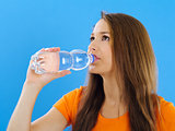 Young woman drinking bottled water