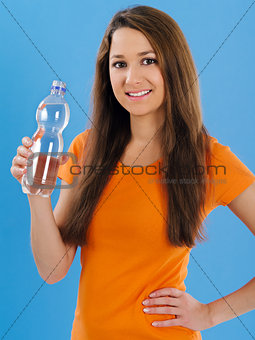 Happy young woman drinking bottled water