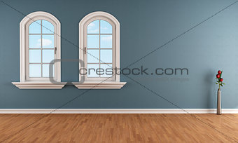 Blue room with two arched windows
