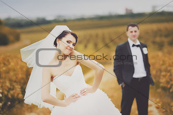 Young newlywed couple in garden.