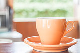Still life with orange espresso coffee cup