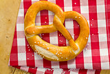 pretzel on checkered napkin