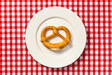 pretzel on white plate