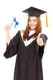 happy Graduate woman Holding diploma and thumb up