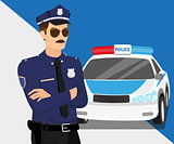 Policeman wearing sunglasses and police car.
